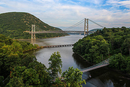 The Hudson Valley: The Bear Mountain, CSX and Pedestrian Bridges where the Popolopen Creek meets the Hudson River. Taken by John Morzen Photography.